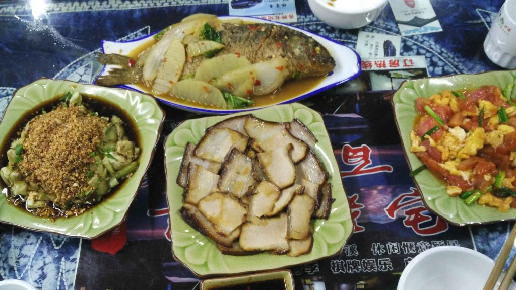 Local braised fish, twice-cooked pork, roasted eggplant with ground peanuts, and scrambled egg with tomato. Not exactly the 'white-people Chinese food' I'd find back home – this is a million times better!