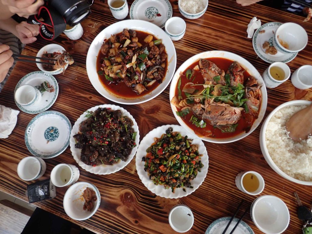 Lunch. There was Kung Pao chicken (the closest thing I can compare it to), cave fungus with chilli, limpets/barnacles (with chilli and vegetables) and whole braised lake fish (…with chilli)