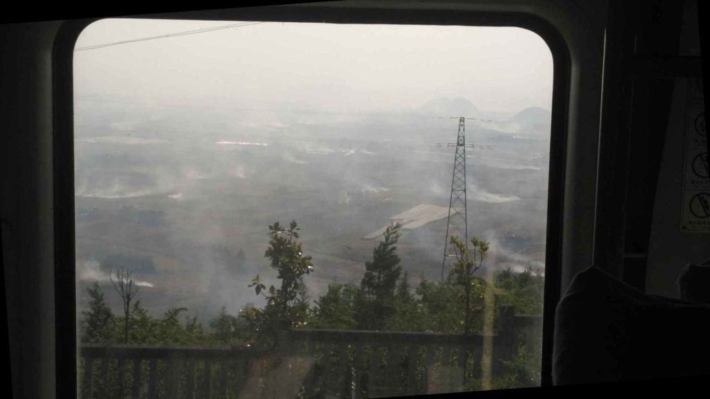 Burning crops to fertilize the fields. I woke up to this outside the train window - I thought I'd missed Kunming and ended up in the 6th circle of hell