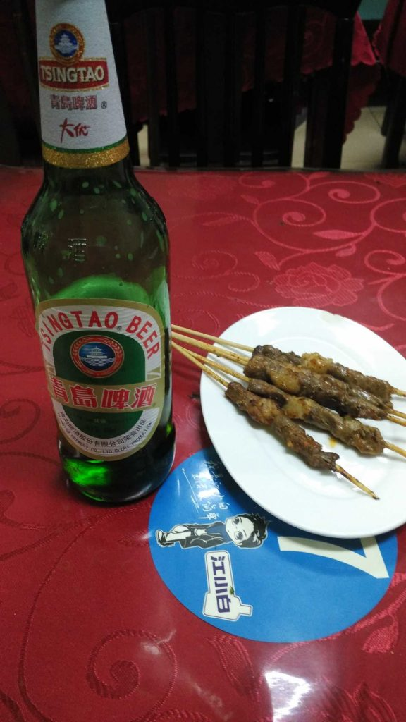 7 yuan for the beer, 3 yuan each for the chuar. They're traditionally mutton, with cubes of fat strategically placed on the skewer which crisp and render.