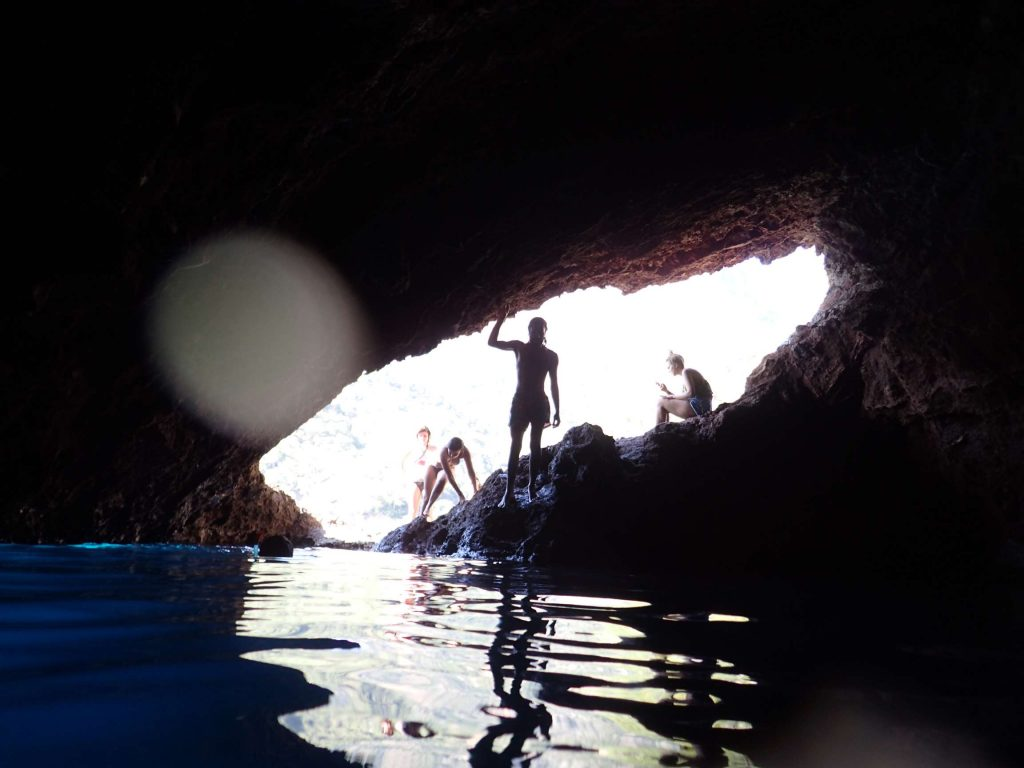 Some friends I later made, silhouetted against the cave opening. This time we swam to the cave from the beach.