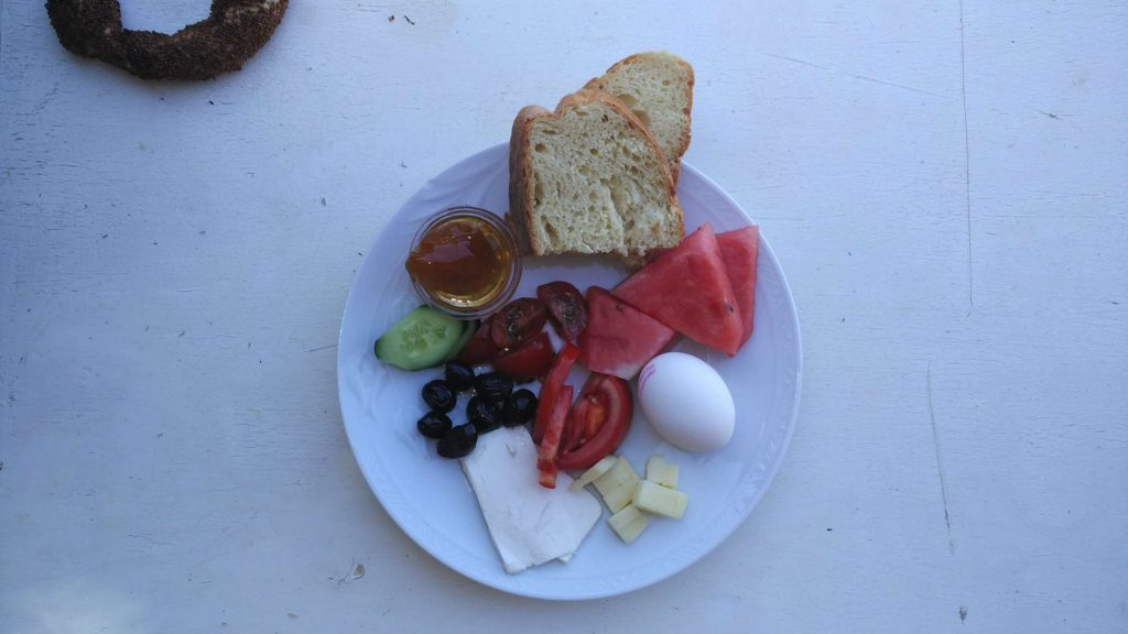 A typical Turkish breakfast. Cheese, bread, fresh fruit and vegetables, eggs, and jam