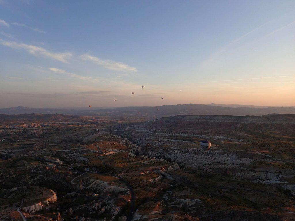 The sun gradually illuminates the Cappadocian moonscape