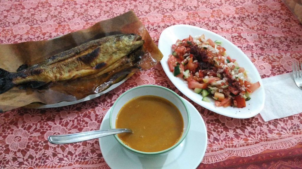 The night's dinner of fried fish, soup, and vegetables – classic Turkish food