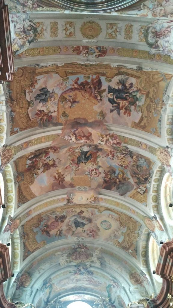 And the roof. Notice the clever optical illusion painted in: the edge of the roof extends into the painting to create the illusion of the roof opening up to the heavens