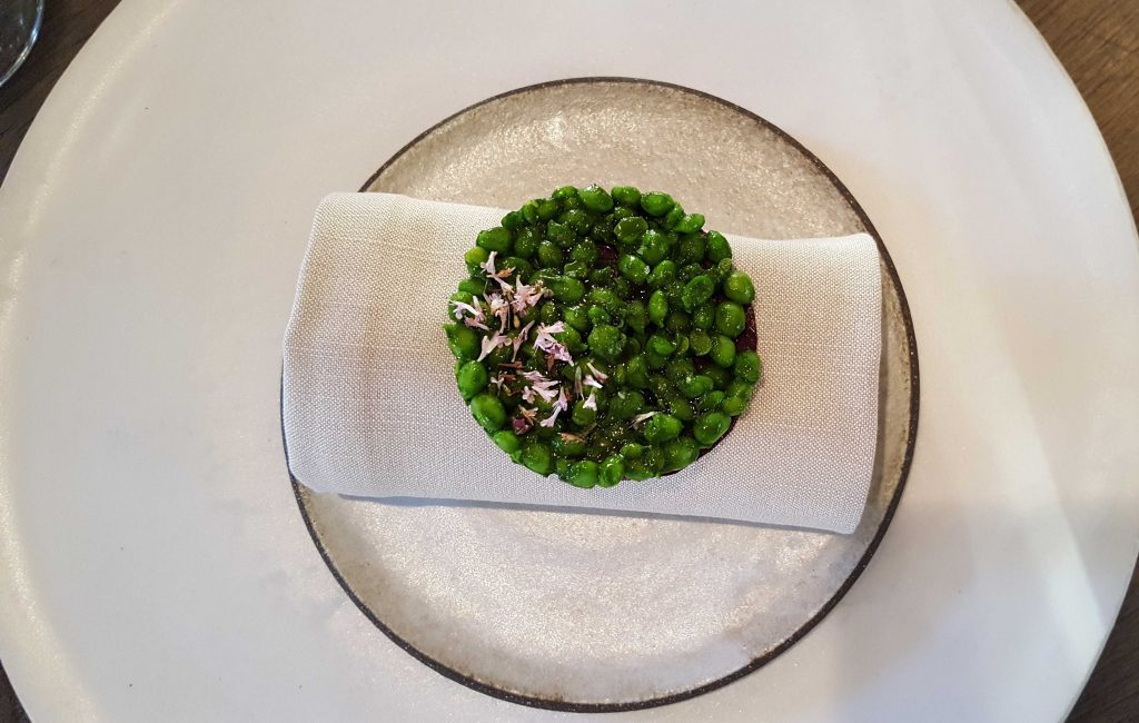 Crisp of wild roses and Danish peas. Delicate and cruncy, the peas were individually peeled by the interns upstairs. The husks are used to make one of the juice courses.